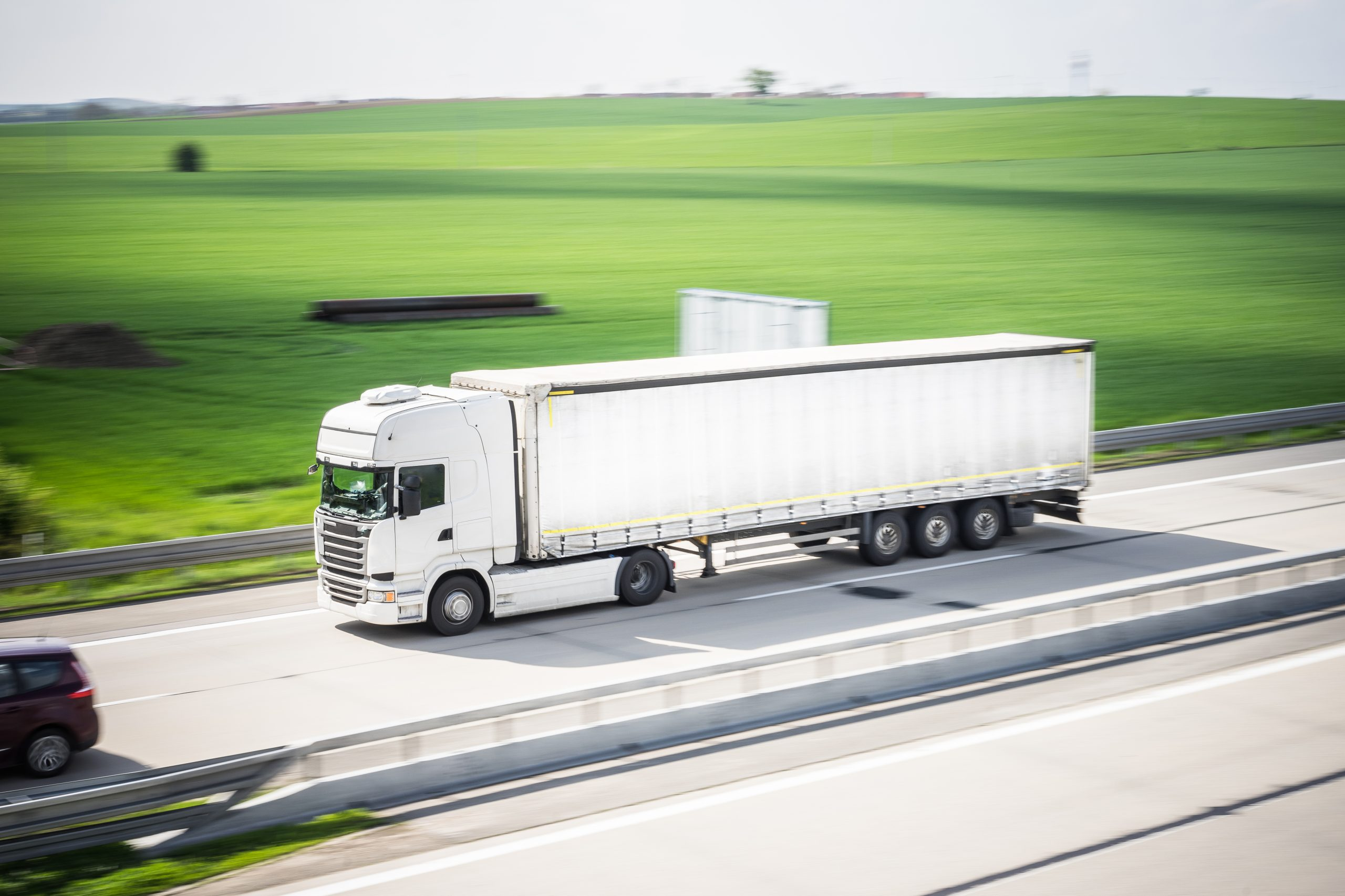 white-tir-truck-in-motion-driving-on-highway-picjumbo-com
